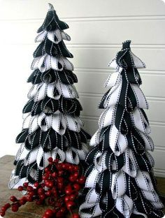 Simple yet elegant trees using ribbon and flat pins! Just get 2 different sizes of styrofoam cones and your choice of ribbon colors.