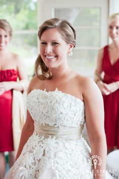 How gorgeous is this bride? Love the lace detailing on her gown!