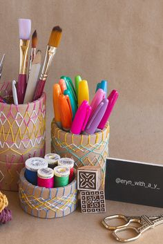 Get your craft on and embroider geometric patterns into leftover cardboard tubes to make a desk set.