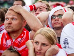 Polish soccer fans react as they watch the game on a giant screen in the Warsaw Fanzone on June 8. About 110,000 soccer fans came to the fan zone in the center of Warsaw to watch the first match of the Euro 2012 soccer tournament between Poland and Greece. (Wojek Radwanski/AFP/Getty Images)