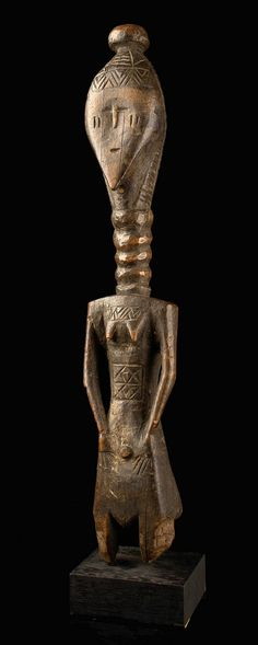 Africa   Female figure from the Mende people of Sierra Leone   Wood, with dark patina.