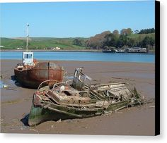 BOAT GRAVEYARD Canvas Print featuring the photograph Boat Graveyard by Richard Brookes.  DESCRIPTION; Once someone's pride and joy, two forlorn wrecks lie abandoned awaiting their inevitable fate. Taken in the mud flats of the River Torridge near to Appledore and Bideford in North Devon, UK.  Photo by & copyright Richard Brookes