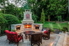 classic patio design with brick pavers and a fire feature wood storage red and brown soffas round coffee table brick floors of Outdoor Corner Fireplace, a Great Warm Spot Outside Your House