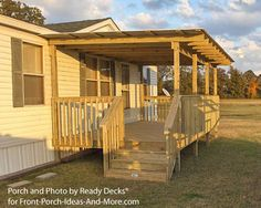 A #porch on mobile home with double staircase and flat roof. Ready Decks for Front Porch Ideas