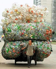 NOT HOT - Bottle it up and let it out to sea - monumental containers moved for recycling in Haikou province, 2003. Half of waste plastics are uncollected or thrown into the ocean