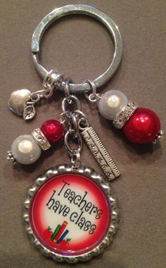 This listing is for one Teacher's Have Class bottle cap key chain.  This key chain will make a great gift for any teacher. It is decorated with red and white beads, an apple charm and a ruler charm.  Thanks for looking! Have a great day!!  Laura