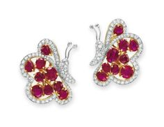 A PAIR OF RUBY AND DIAMOND EAR CLIPS Each designed as a single-cut diamond butterfy, extending cushion and pear-shaped ruby wings with single-cut diamond trim, mounted in 18k gold