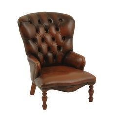 Alameda Leather Chair at Found Vintage Rentals. Small dark leather chair with button tufting