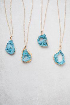 Aqua colored geode druzy pendant necklace.