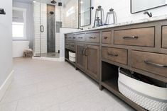 Master Bath with grey tiled flooring and subway tile shower walls Tiled Showers, Subway Tile Showers, Shower Walls, Shower Doors, Kitchen Flooring, Kitchen Cabinets, Double Vanity, Backsplash, Master Bath