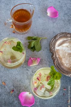 This delicately perfumed light, fizzy Rose and Cucumber Collins cocktail is a perfect pre-dinner sipper. With refreshing cucumber and a homemade rosewater syrup it is the perfect compliment to aromatic gin.