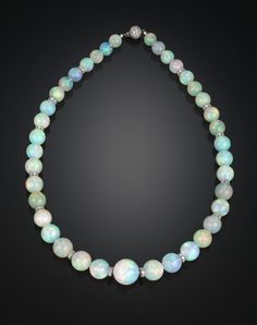 """Estate Jewelry, White Opals, Graduated Opal Bead Necklace ~ M.S. Rau Antiques. Thirty-nine incredibly rare and large opal beads, weighing an amazing 386.00 total carats. The opals are adorned by platinum rondelles and secured with an 18K white gold ball clasp, all of which are bejeweled with 4.46 carats of sparkling white diamonds. 19"""" length. $188,500"""
