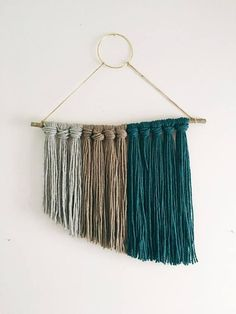This one of a kind handmade wall hanging adds interest and color to any room with its unique shape and underwhelming color palette. Crafts To Do, Yarn Crafts, Kids Crafts, Weaving Wall Hanging, Wall Hangings, Yarn Wall Art, Handmade Wall Hanging, Weaving Projects, Modern Wall Decor