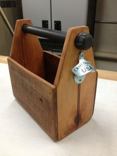 Repurposed Beer tote made from barn wood with packing crate sides. Galvanized pipe handle with Starr bottle cap opener.
