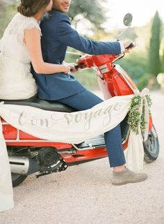 """Say """"bon voyage"""" to your wedding guests as you exit your special day on this gorgeously decorated scooter like these newlyweds!"""