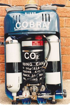 """The Cobra"" was an experimental diving unit that was intended for military use as a  ""Fully Close Circuit Rebreather"" using ""100% Pure Oxygen"". And as a ""Semi Close Circuit Mixed Gas Rebreather"" using gas mixture called ""Nitrox B"" 60% oxygen & 40% nitrogen,  ""Nitrox C"" 40% oxygen & 60% nitrogen,  ""Nitrox D"" 32.5 oxygen & 67.5% nitrogen.  ""Heliox""  Oxygen & Helium & ""Trimix"" Oxygen, Helium & Nitrogen."