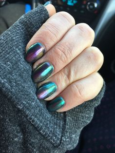 Oil spill nails. Russian Navy OPI gel topped with chrome dust and a gold magnetic cat eye.