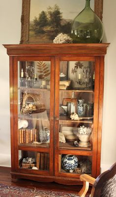 I love glass cabinets like this. Want one for the dining room or lake house.