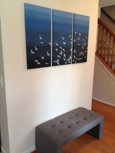 Entryway wall art: Here's a fun, easy, and relatively inexpensive way to get high-impact art for an entryway or large wall. I bought three 15 x 30 in. stretched canvases from Amazon.com and painted them in shades of blue with acrylic craft paint from Michaels. I used a wall stencil (Flock of Cranes, Cutting Edge Stencils) and silver craft paint to create the crane design. Anyone with basic painting skills can do this (be sure to check out the instructional videos at CuttingEdgeStencils.com).