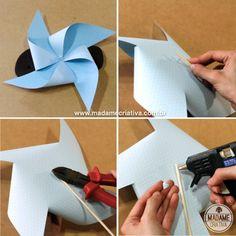 Como fazer um Cata-vento - Passo a Passo 1-Corte um quadrado de papel de 20cm x20cm e trace duas diagonais com uma régua. 2-Faça 4 cortes de 8,5cm no papel, começando a cortar pelas pontas. 3-Cole uma ponta do papel no centro do papel com cola quente e em seguida cole as outras 3 pontas para que o papel fique com forma de cata-vento. Use pouca cola. 4-Passe cola no flor de papel recortada com cortador e cole bem no centro para arrematar. Se não tiver cortador pode cortar qualquer forma…