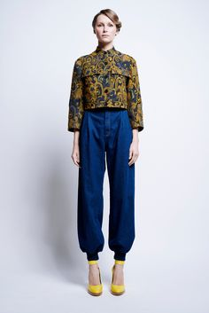 This is an outfit by Karen Walker Pre-Fall 2016 Fashion Show. This look references the Eisenhower jacket with its pockets and shape. The jacket is modified and updated by featuring a patterned textile.