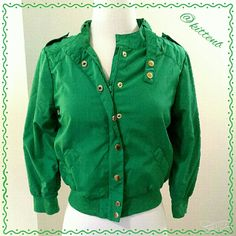 Divided by H&M Green bomber jacket Rock it out in this adorable cropped jacket that is a take on Members Only. Size 4 from H&Ms Divided line. 100% polyester. Ribbed bottom and cuffs on 3/4 sleeves. Unlined. Zip and snap front closure. Some tarnish on brass colored snaps. Divided Jackets & Coats
