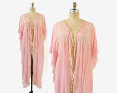 Beautiful vintage 1920s semi sheer silk dressing gown. Bubblegum pink silk crepe with delicate lace. Wide pointed sleeves. Open front; no closures.  Label: none present  One size fits most due to open cut. See measurements to be sure.  Bust: 60 Shoulder: 17 Sleeve: 7 from natural shoulder Waist: free Length: 49  Excellent vintage condition. No stains, flaws or significant issues.  Shop Our Collection of Vintage Lingerie HERE: http://etsy.me/1OvyPbM  Instagram | LuckyDryGoods Fa...