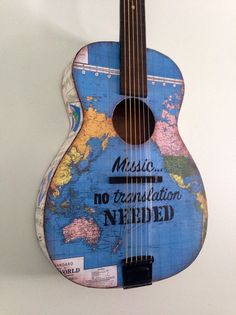 Hey, I found this really awesome Etsy listing at https://www.etsy.com/listing/266228019/vintage-world-map-acoustic-guitar-art