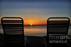 """While out on the beach there are two empty chairs That say more than the people who ever sit there."" ~Jimmy Buffett. Just catching a sunset at Key Largo, Florida"
