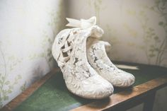 Beautiful Bride Cari wore our vintage 'Lottie Elliot' handmade lace wedding boots to her historic Welsh wedding #houseofelliot #weddingboots #vintageboots
