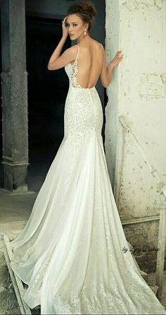 #wedding #bride #weddingdress #weddinggown #bridal | Couture looking Designer Wedding Dress with incredible lace detailing and long train. Open back bridal gowns with spaghetti straps.  www.dariuscordell.com/featured/custom-wedding-dresses-bridal-gowns/