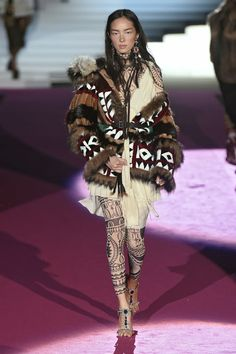 DSquared2. Leggings as layering pieces were HUGE in Milan. See all the fashion week runways with the trend.