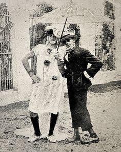 """1920 street carnival in Rio  Foliões pertencentes ao Clube de Regatas São Cristóvão, localizado em bairro homônimo, durante o Carnaval, um dos quais fantasiados de mulher. Os homens fantasiados de mulheres durante o carnaval são apelidados no Rio de """"cutruvias"""". Rio de Janeiro, fevereiro de 1920."""