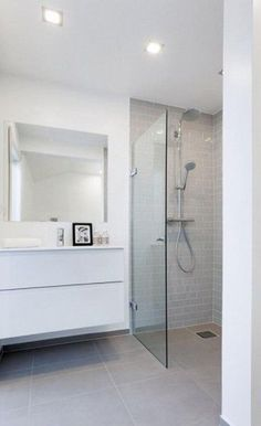 white bathroom with floating counters and semi open shower area