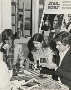 Mark Hamill, Carrie Fisher and Harrison Ford signing books at a Toronto book store, 1977.