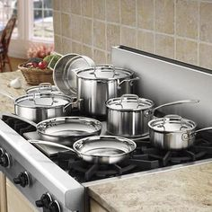 The Cuisinart® MultiClad Pro Triple Ply Stainless Cookware 12 Piece Set is an essential in every kitchen. Cuisinart Cookware, Cookware Set, Kitchenware Set, Kitchen Trash Cans, Pots And Pans Sets, Pan Set, Kitchen Dining, Dining Room, Kitchen Appliances