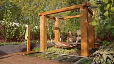 Jamie Durie's Sri Lankan-inspired garden has this pergola with floating bed (from all 4 corners it is tied from grommeted corners to the pergola.  This is located above the pond + suspended from a pergola of chunky timber beams
