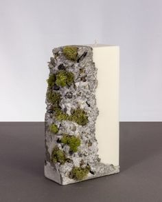Hand-made from 100% soy wax products, this pillar candle is a delightful addition to any interior, or event space. Made using a completely unique method that is patent pending, this product features a sculpted concrete element decorated by natural dried moss. #scentedcandles #decorativecandles #candlesandholders #handmade #candlestore #luxurycandles #baycandles #soycandles #exclusivegift #patented #decore #candle