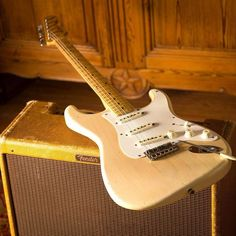 Here we see a spry '57 Stratocaster in its natural habitat: planking on a vintage Fender amp.
