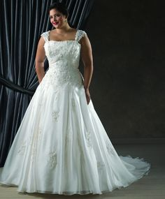 #weddings #plussizebrides #bridestobe #weddinggown #brides | Plus Size Bridal Gown with beaded lace | Lace Bodice Wedding Dress for Plus Size Bride | This empire waist gown for the fuller figure bride has beaded lace straps going over the top of the shoulder | We can make an extremely similar style in any size or with any changes. We are located here in the USA and offer affordable made to order plus size wedding dresses…