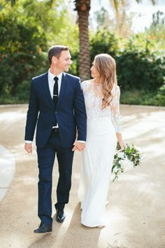 Stylish groom in navy blue…