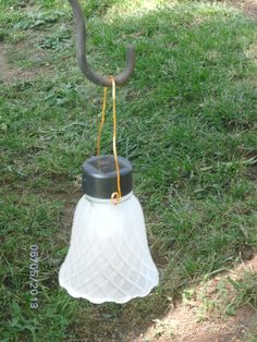 An old glass lamp shade, a cheap solar light and a little wire.