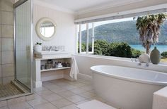 The comfortable Leisure Isle Lodge is on a tiny island set in the vast Knysna Lagoon which is connected to the mainland by a narrow road, resulting in a unique haven of peace and tranquillity. Knysna, Have A Shower, Bathroom Windows, Best Bath, Window View, Clawfoot Bathtub, Great View, Lodges, House Styles