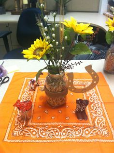 Western Centerpiece for Office Retirement Party: Mason jars filled with hay, Sunflower, wildflower, and wheat for decor and jar wrapped in a burlap bow. Designed by: DylanandMommy