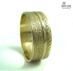 An exquisitely detailed Art Deco style wedding band ring.  This beautiful 14k yellow gold is engraved in romantic haute couture pattern.Designed for men and women.  Like true love stands the test of time so is this haute couture design.