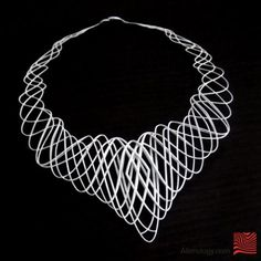 3D printed Guilloche necklace, alienology at Shapeways.  I own this.  It has a bit more relief than the photo shows.  It's amazingly light, but slightly fragile.