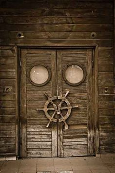 Old wooden door on an abandoned boat,