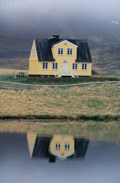 yellow house reflecting in a lake, Iceland