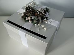 Make card box..  grey/silver with ribbon and correct flower on top..