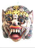 """Barong Dance Theater Mask Wall Decor- 16.5"""". The most important figure in Balinese mythology and a central figure of the famous Barong Dance, the Barong is a common subject of many of handicrafts and artistic creations. Usually displayed outside Balinese homes and on temple altars, this powerful image is believed to ward off evil spirits and promote well being. Handcarved from prized albesia wood and embellished with vibrant colors and traditional gold leaf, this stunning mask is truly a…"""